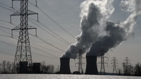Smoke-rises-from-the-nuclear-power-plant-at-Three-Mile-Island-Pennsylvania-with-power-lines-foreground