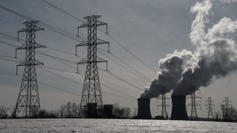 Smoke-rises-from-the-nuclear-power-plant-at-Three-Mile-Island-Pennsylvania-with-power-lines-foreground-1