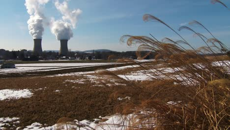 Smoke-rises-from-the-nuclear-power-plant-at-Three-Mile-Island-Pennsylvania-with-farm-fields-foreground
