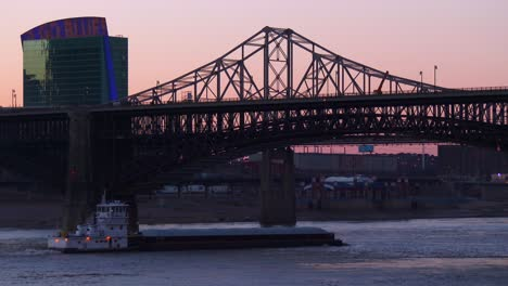 Small-barge-travels-under-a-bridge-along-the-Mississippi-River-near-St-Louis