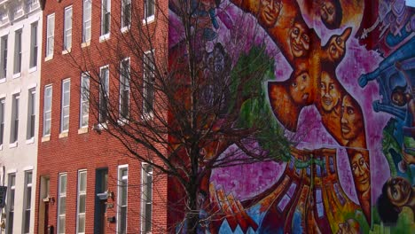 Buildings-are-painted-with-beautiful-art-in-a-Baltimore-slum