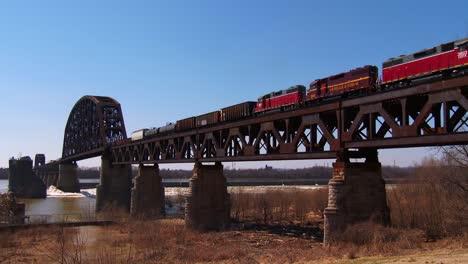 Freight-train-moves-across-a-tall-steel-bridge-1