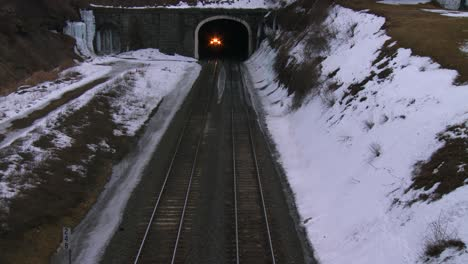 High-angle-over-a-passenger-train-going-through-a-tunnel-in-the-winter