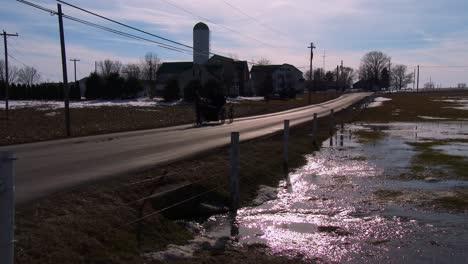 Amish-horse-cart-rolls-along-a-road-in-rural-Pennsylvania