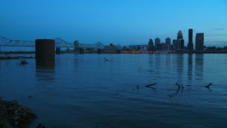 Beautiful-shot-of-Louisville-Kentucky-across-the-Ohio-River-at-night