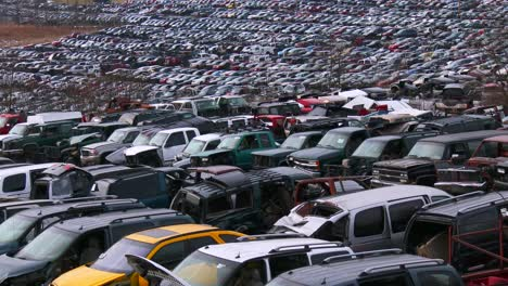 Cars-sit-in-rows-in-a-junkyard-in-the-snow-1
