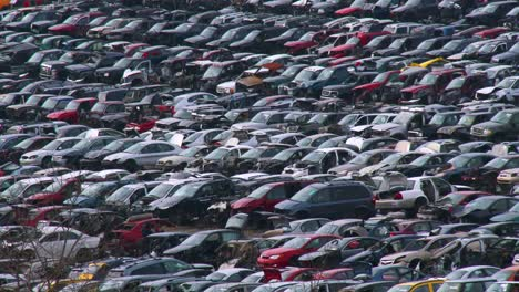 Cars-sit-in-rows-in-a-junkyard-in-the-snow-2