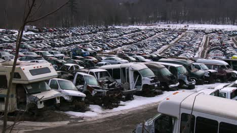 Cars-sit-in-rows-in-a-junkyard-in-the-snow-4