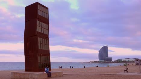 An-odd-sculpture-stands-on-a-beach-in-Barcelona-Spain