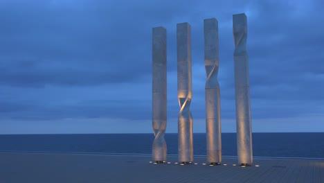 Sculpture-is-lit-along-the-beach-in-Barcelona-Spain