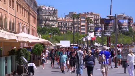 People-walk-near-the-beach-in-Barcelona-Spain