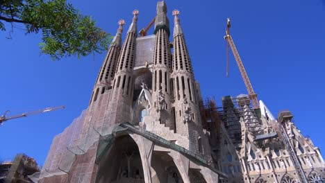 Low-angle-view-of-the-Sagrada-Familia-cathedral-by-Gaudi-in-Barcelona-Spain