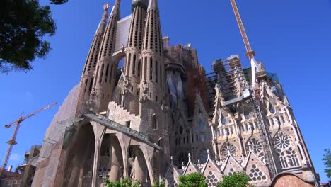 Tilt-up-from-the-base-of-the-Sagrada-Familia-cathedral-by-Gaudi-in-Barcelona-Spain