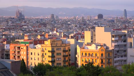 The-distant-skyline-of-Barcelona-Spain-with-Sagrada-Familia-distant-and-apartments-foreground