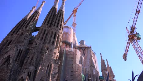 Low-angle-view-of-Sagrada-Familia-cathedral-by-Gaudi-under-construction-in-Barcelona-Spain