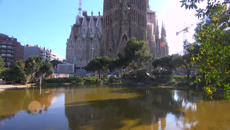 Tilt-up-to-view-of-Sagrada-Familia-cathedral-by-Gaudi-under-construction-in-Barcelona-Spain