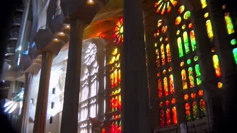 Sunlight-streams-through-stained-glass-in-the-beautiful-interior-of-the-Sagrada-Familia-Cathedral-by-Gaudi-in-Barcelona-Spain