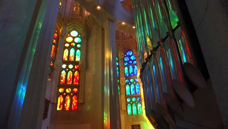Sunlight-streams-through-stained-glass-in-the-beautiful-interior-of-the-Sagrada-Familia-Cathedral-by-Gaudi-in-Barcelona-Spain-1