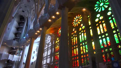 Sunlight-streams-through-stained-glass-in-the-beautiful-interior-of-the-Sagrada-Familia-Cathedral-by-Gaudi-in-Barcelona-Spain-3