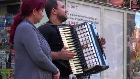Street-musicians-perform-on-a-Barcelona-Spain-street