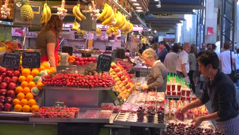 Vendors-sell-their-goods-in-an-indoor-market-in-Barcelona-Spain-1