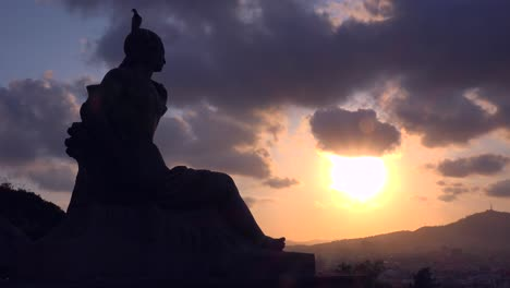 The-sun-sets-behind-a-Roman-statue-in-downtown-Barcelona-Spain