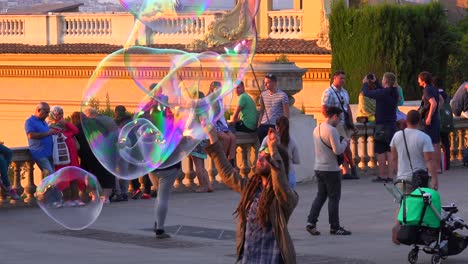 A-performance-artist-makes-large-bubbles-in-Barcelona-Spain