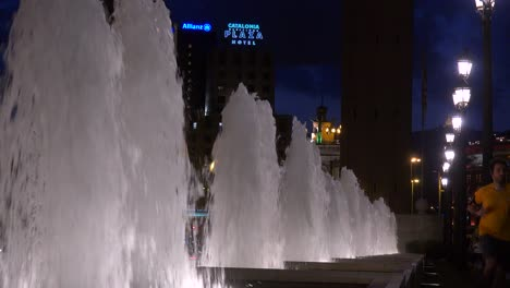 Fountains-dance-in-Barcelona-Spain-with-a-hotel-background