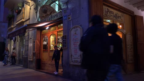 Classic-establishing-shot-of-a-bar-or-cafe-at-night-in-European-style