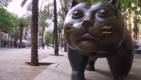 A-large-sculpture-of-a-cat-sits-along-a-street-in-Barcelona-Spain