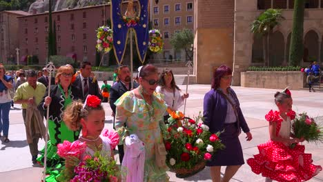A-Catholic-religious-procession-arrives-at-the-Montserrat-Monastery-in-Spain