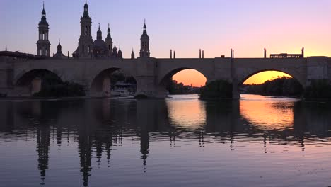 A-classic-and-beautiful-stone-bridge-in-Zaragoza-Spain-with-cathedral-background