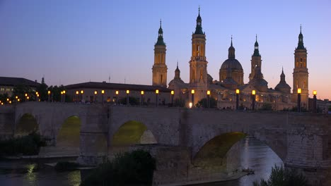 A-classic-and-beautiful-stone-bridge-in-Zaragoza-Spain-with-Catholic-cathedral-background