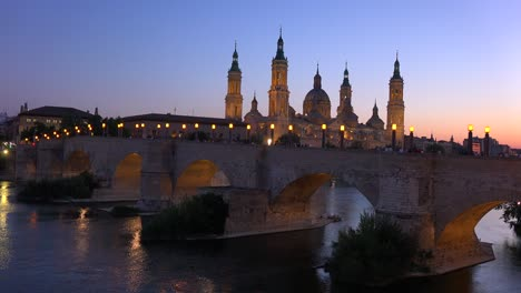 A-classic-and-beautiful-stone-bridge-in-Zaragoza-Spain-with-Catholic-cathedral-background-1