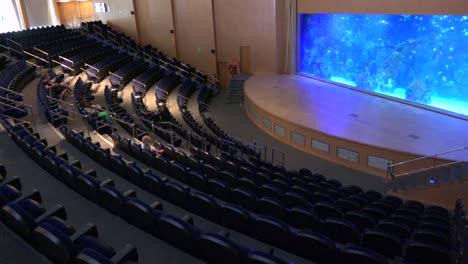 A-beautiful-auditorium-at-an-oceanographic-institute-features-an-aquarium-display