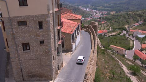 Cars-travel-along-narrow-cobblestone-streets-in-the-beautiful-castle-fort-town-of-Morella-Spain