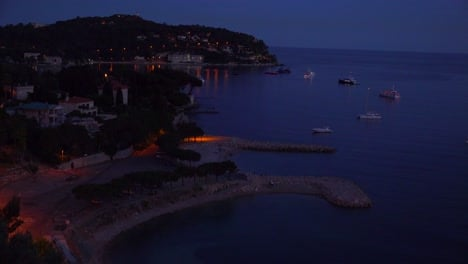 High-angle-over-France-s-amazing-Cote-D-Azur-at-night-1