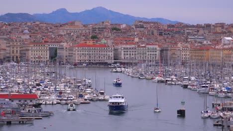 Boats-enter-and-exit-the-harbor-in-Marseilles-France