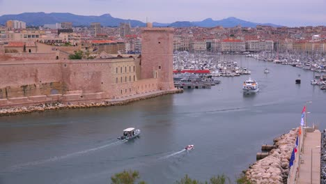 Boats-enter-and-exit-the-harbor-in-Marseilles-France-1