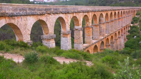 A-beautiful-Roman-aqueduct-crosses-a-canyon-in-France