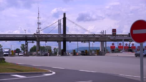 Trucks-and-cars-pass-through-a-tollbooth-on-a-French-motorway