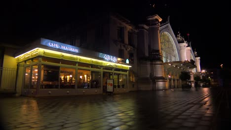 Exterior-of-a-railway-station-and-diner-restaurant-in-France-at-night