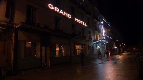 A-neon-sign-announced-the-Grand-Hotel-in-a-rainy-French-city