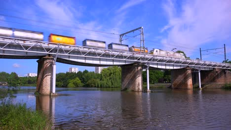 A-freight-train-speeds-across-a-bridge-in-Europe
