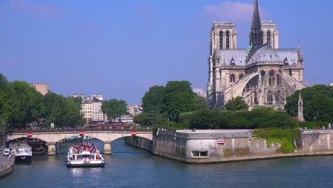 A-riverboat-travels-under-bridges-near-the-Notre-Dame-cathedral-in-Paris-4