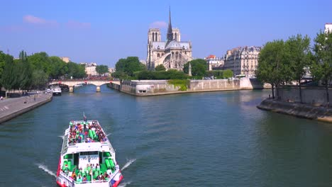 A-riverboat-travels-on-the-Seine-near-the-Notre-Dame-cathedral-in-Paris-1