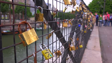 The-Pont-Des-Artes-bridge-in-paris-features-locks-from-couples-expressing-their-eternal-devotion