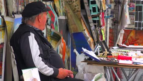 A-street-vendor-in-Paris-sells-magazines-and-artwork-1