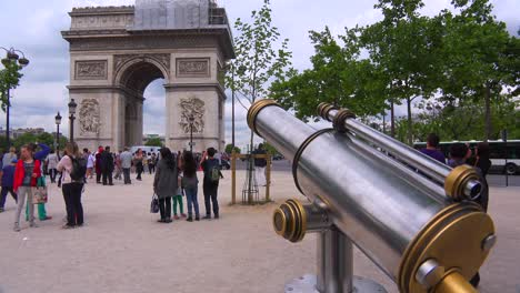 The-Arc-De-Triompne-in-Paris-with-a-telescope-viewer-foreground
