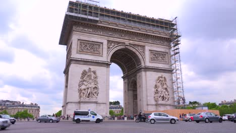 An-ambulance-or-emergency-vehicle-circles-around-the-Arc-De-Triomphe-in-Paris-France